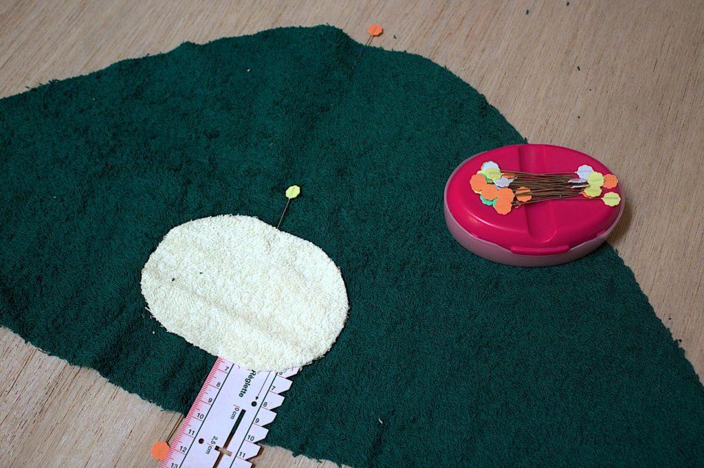 posizionare il musetto al centro del cappuccio