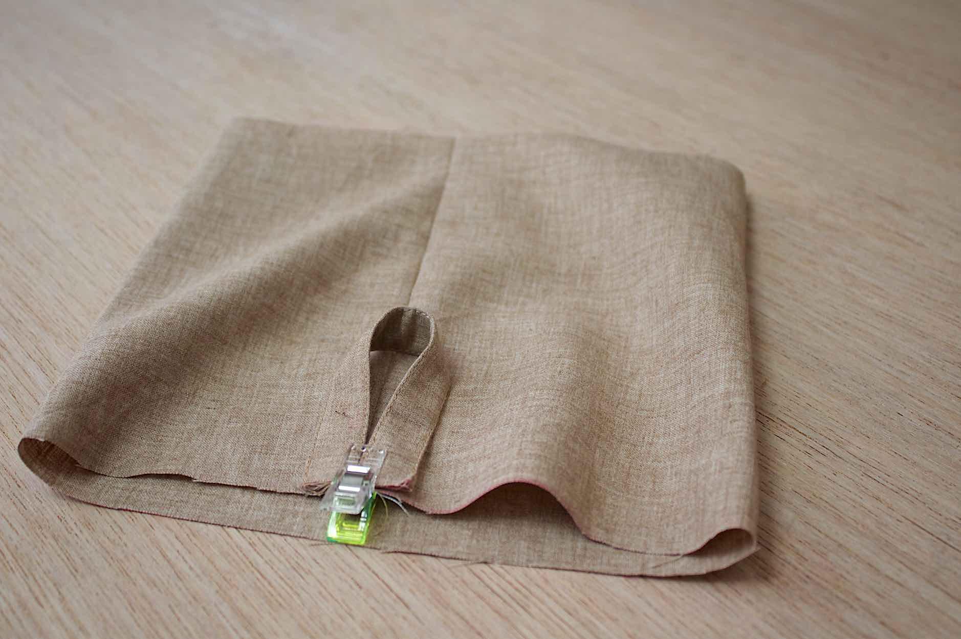 cucite l'anello di aggancio al tessuto principale
