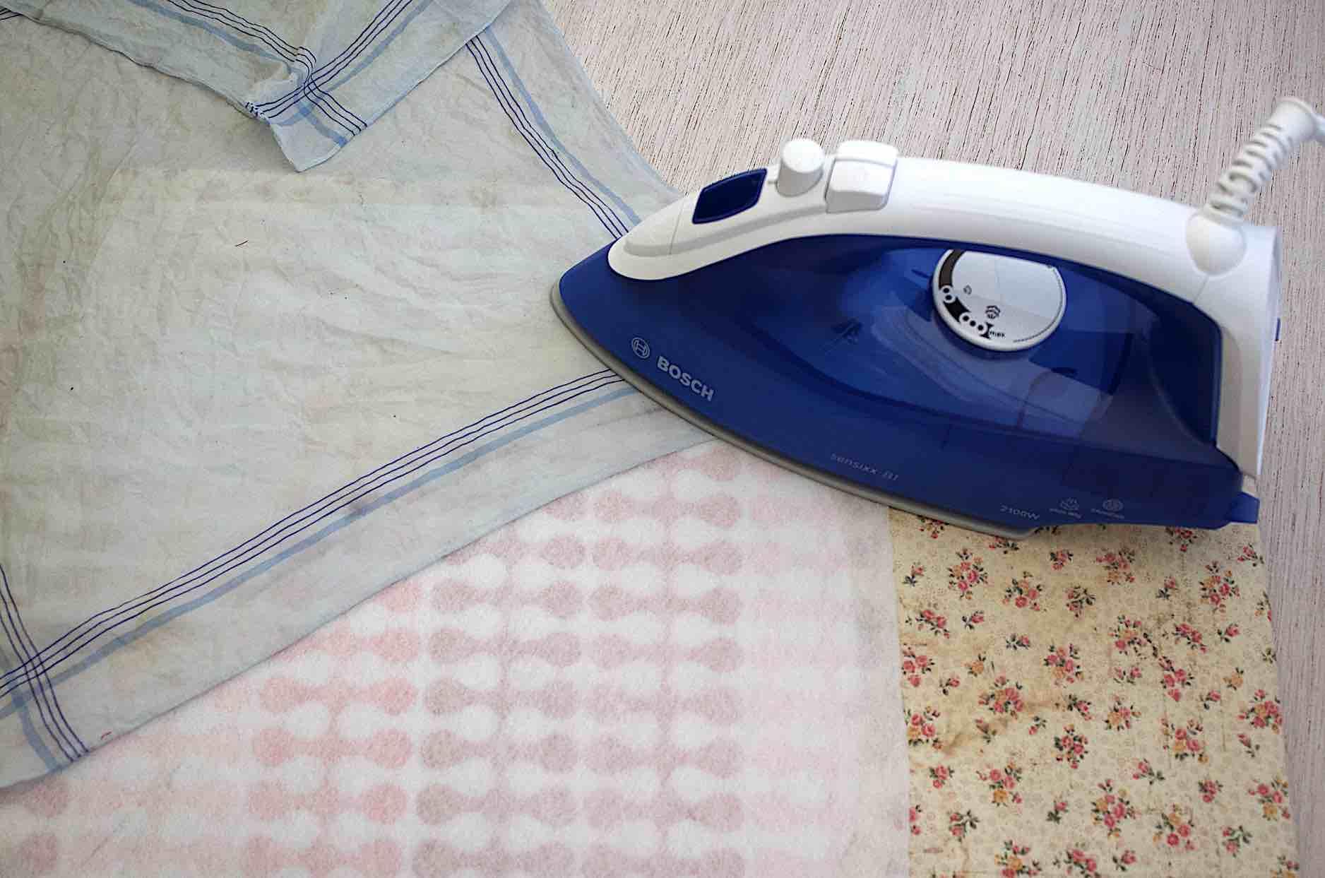 applicare lo stabilizzatore con un panno inumidito e il ferro senza vapore